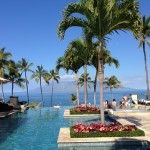 The infinity pool at the Four Seasons Wailea offers the best sunset view - and the best artisanal cocktails - Maui has to offer. (photo: Melanie Haiken)